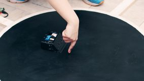 Small wheeled DIY robot detects objects ahead on competition arena Stock Photography