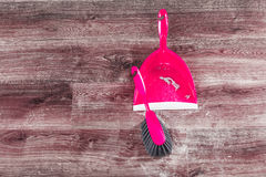 Small whisk broom and dustpan on wooden floor Stock Photography