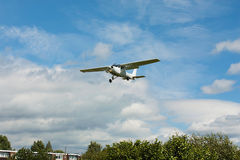 Small white airplane landing Royalty Free Stock Photos