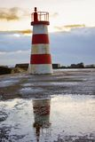 Small White And Red Lighthouse Stock Photo