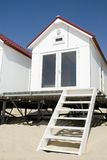 Small white beach house. Closeup of a small, white beach house or temporary cottage on a portable platform royalty free stock images