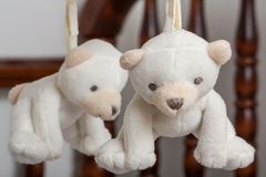 Childs mobile. Small white bears hanging on a mobile isolated fluffy soft child cute smile youth young childhood happy adorable relax fun toy sleep tired nap fur stock photos