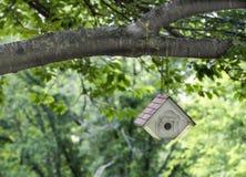 Small White Bird House In Cherry Tree stock image