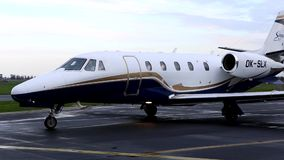 Small white and blue jet plane departing stock video footage