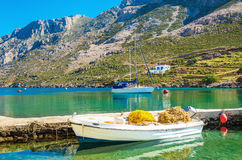 Small white boat with fish nets , Greece Royalty Free Stock Images