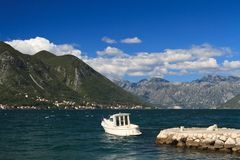Small white boat moored to the dock. Montenegro Royalty Free Stock Photos