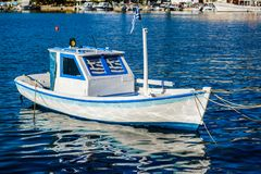 Small white boat in the old harbor of Thasos Town. On the Thasos Island in Greece Stock Photos