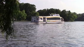 Small white boat. Small recreation boat floating on a park lake stock video