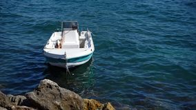 White boat on sea. Small white boat on the sea royalty free stock photography