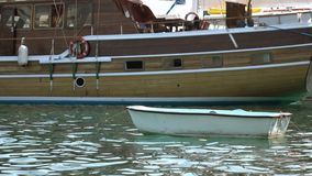 A small white boat on the water.  stock footage