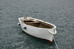A small white boat on the water Royalty Free Stock Images