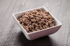 Small white bowl of cooked ground meat Royalty Free Stock Photography