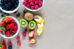 Small white bowls filled with ripe berries. Stock Photo