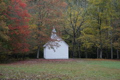 Small white building by a forest Stock Image