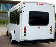 Small white bus. Back of a small white commuter or passenger shuttle bus Stock Images