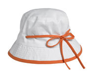 Small white cap with an orange bow Royalty Free Stock Photography