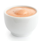 Small white ceramic dish of pink sauce. Royalty Free Stock Image
