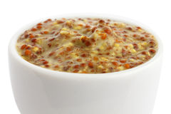 Small white ceramic dish of French dijon mustard. Royalty Free Stock Image