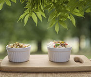 Small white ceramic dishes with rise and curry, beans sprouts on Stock Photos