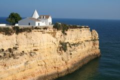 Small white chapel on a cliff Royalty Free Stock Photo