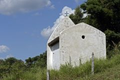 Small white chapel under blue sky Royalty Free Stock Photo