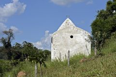 Small white chapel under blue sky Stock Image
