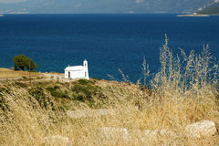 Small white church on the Aegean coast Stock Photos