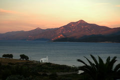 A small white church on the Aegean coast at sunset Stock Photography