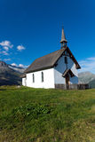 Small white church in the alps royalty free stock photo
