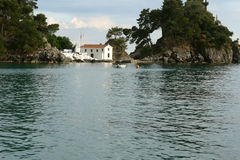 Small white church in bay of Parga town. Royalty Free Stock Image