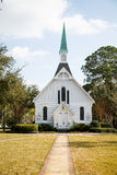 Small White Church Down Sidewalk Royalty Free Stock Photography