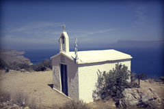 Small white church and Greek flag Stock Photography
