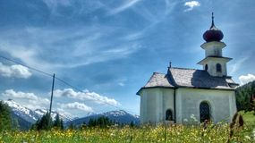 Small white church in a mountain landscape Royalty Free Stock Image
