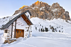 Small white church at Passo Falzarego near La Villa village, Dolomites Mountains Royalty Free Stock Images