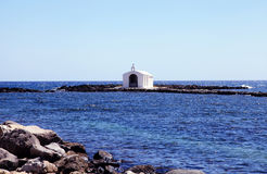 Small white church in sea near Georgioupolis, Crete, Greece Stock Image