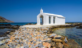 Small white church in sea near Georgioupolis town on Crete island Royalty Free Stock Photos