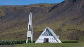Small white church in Iceland. Small white church with separate steeple in  South Iceland Royalty Free Stock Images