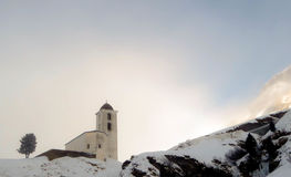 Small white church in winter in the Swiss Alps Royalty Free Stock Image