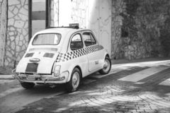 Small white classic Italian Retro taxi funny car, travel, tour and tourism, Italy black and white royalty free stock image