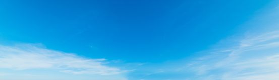 Small white clouds and blue sky royalty free stock photo