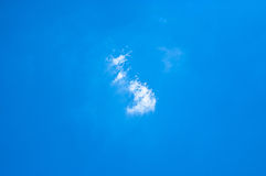 Small white clouds on light blue clear sky Royalty Free Stock Photos