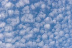 Small white cumulus clouds in blue sky Royalty Free Stock Photography