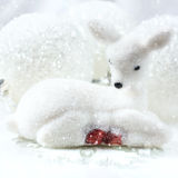 Small white deer and christmas decorations  background. Stock Image