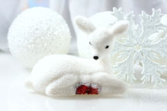 Small white deer and christmas decorations  background. Stock Photography