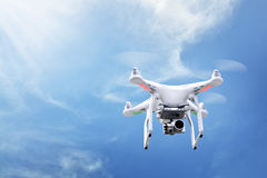 Small white drone hover. With blue sky background stock photo