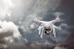 Small white drone hover Royalty Free Stock Photo
