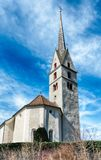 Small white European church in a Swiss alpine village in the Grisons. Village church in Malans village in he Grisons of Switzerland royalty free stock photography