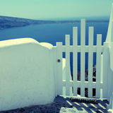 Small white fence gate and sea view in Oia on Santorini island, royalty free stock photography