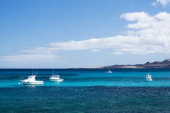 Small white fisher boats at Lanzarote coast Royalty Free Stock Photos