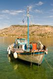 A small white fishing boat Stock Photography